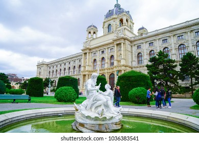 VIENNA AUSTRIA _ SEPTEMBER 2; Gardens in Maria Theresa Place in front of arts museum building, pond with white statue,  grounds and people September 2 2017 Vienna Austria