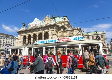 VIENNA, AUSTRIA - APR 24, 2015: people in front of Vienna State Opera house - the Hofburg - with history dating back to mid-19th century. It is located in centre of Vienna