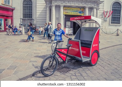 VIENNA, AUSTRIA, APRIL, 2015: A red bicycle taxi for sightseeing in Vienna city center, Vienna, Austria.