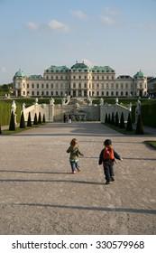VIENNA, AUSTRIA - APRIL 22, 2010: Running children in Belvedere Palace Gardens in Vienna, Austria