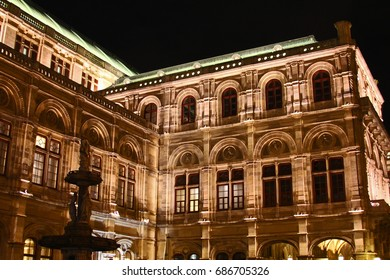 VIENNA, AUSTRIA - April 24, 2017 - Night view of Staatsoper opera house and statue