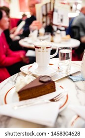 Vienna, Austria - April 3, 2013: The Sacher cake, in German Sachertorte, is a typical Austrian chocolate cake created and served at the Hotel Sacher daily to hundreds of tourists.