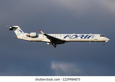 VIENNA / AUSTRIA - APRIL 6, 2018: Adria Airways Bombardier CRJ-900 S5-AAK passenger plane landing at Vienna International Airport