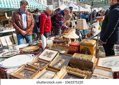 Vienna, Austria - April 7, 2018: Every Saturday is a flea market at Naschmarkt areain Vienna. Local people and lots of tourists visit the market and looking for bargains and antique stuff.