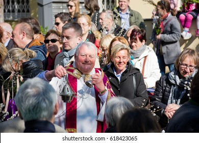 VIENNA, AUSTRIA - APRIL 9, 2017: Consecration of the palm branches with a large number of faithful on Palm Sunday outdoors with subsequent procession to the parish church in Gersthof.