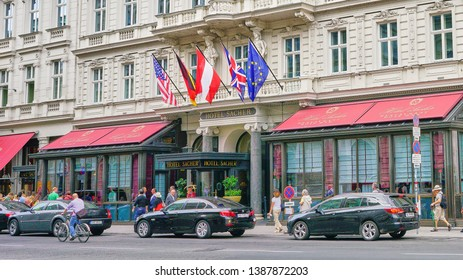 Vienna, Austria - Aug 2018: Street view of the facade of the world famous Sacher Hotel in downtown Vienna, known as the home of the best chocolate Sacher Tort cake in the world.
