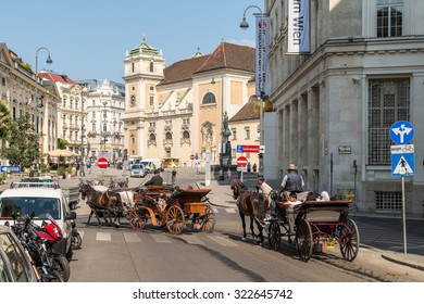VIENNA, AUSTRIA - AUGUST 10, 2015: Busy Traffic And People On Downtown Streets Of Vienna City In Summer.