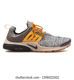 VIENNA, AUSTRIA - AUGUST 10, 2017: Nike Air Presto SE QS black, grey and yellow sneaker on white background.