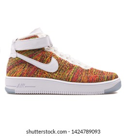 VIENNA, AUSTRIA - AUGUST 10, 2017: Nike Air Force 1 Ultra Flyknit Mid volt multi color sneaker on white background.