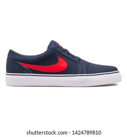 VIENNA, AUSTRIA - AUGUST 10, 2017: Nike Satire 2 navy blue and red sneaker on white background.