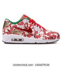 VIENNA, AUSTRIA - AUGUST 10, 2017: Nike Air Max 90 QS white, red and gold sneaker on white background.