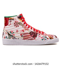VIENNA, AUSTRIA - AUGUST 10, 2017: Nike Blazer Mid QS red, white and gold sneaker on white background.