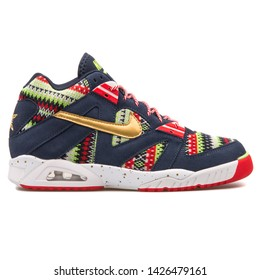 VIENNA, AUSTRIA - AUGUST 10, 2017: Nike Air Tech Challenge 3 QS obsidian, red, green and gold sneaker on white background.