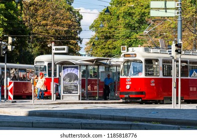 VIENNA, AUSTRIA - AUGUST 13, 2012: A tram stop with a standing tram and a large number of hanging wires. Veinna. Austria