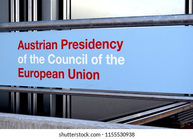 """VIENNA, AUSTRIA - AUGUST 13, 2018: """"Austrian Presidency of the Council of the European Union"""". Text written on a panel at the entrance of Austria Center Vienna, a conference center in Vienna."""