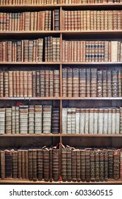 VIENNA, AUSTRIA - AUGUST 14, 2016: Old books on wooden shelves in The State Hall (Prunksaal), the heart of the Austrian National Library, biggest Baroque library in Europe with 7.4 million items.