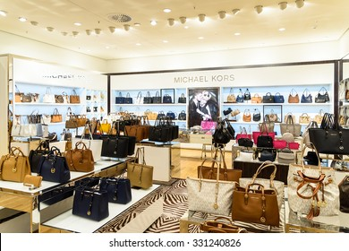 VIENNA, AUSTRIA - AUGUST 15, 2015: Michael Kors Holdings is a fashion company established in 1981 by American designer Michael Kors and is known for luxury handbags and accessories.