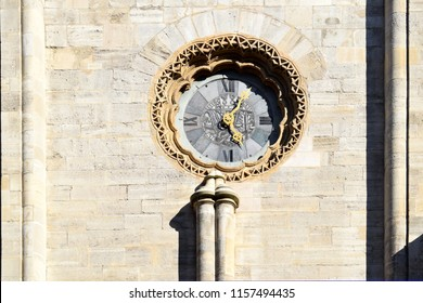 VIENNA, AUSTRIA - AUGUST 15, 2018: Clock on a wall of St. Stephen's Cathedral (Stephansdom) in Vienna, Austria. A romanesque/gothic-style Roman Catholic church, built during the Middle Ages.