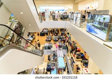 VIENNA, AUSTRIA - AUGUST 20, 2015: People Crowd Rush In Shopping Luxury Mall Interior.