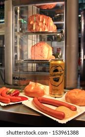 VIENNA, AUSTRIA - AUGUST 2012 : Ottakringer beer, sausages at Wurstelstande Hot dog stand on Kaerntner Strasse shopping street on August 8, 2012, Original Vienna's sausage stands in Vienna, Austria