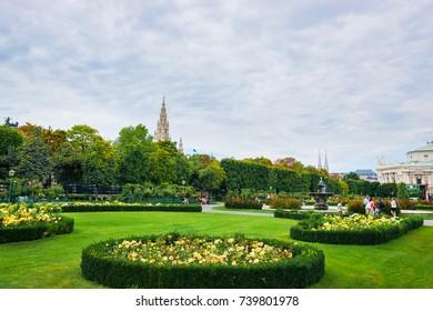 Vienna, Austria - August 21, 2012: Volksgarten or People Garden park of Hofburg Palace in Vienna, in Austria. Tourists on the background