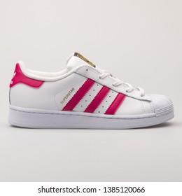 VIENNA, AUSTRIA - AUGUST 23, 2017: Adidas Superstar Foundation white and pink sneaker on white background.