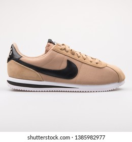 VIENNA, AUSTRIA - AUGUST 23, 2017: Nike Cortez Basic Premium QS desert camo and black sneaker on white background.