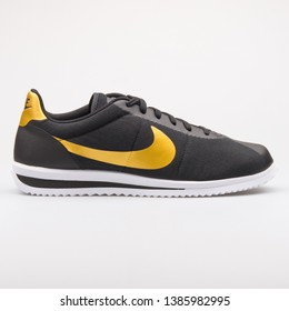 VIENNA, AUSTRIA - AUGUST 23, 2017: Nike Cortez Ultra QS black and gold sneaker on white background.