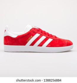 VIENNA, AUSTRIA - AUGUST 23, 2017: Adidas Gazelle red and white sneaker on white background.