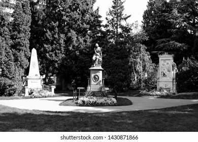 Vienna, Austria - August 24, 2014:  Tombstone of the famous musicians Beethoven Mozart and Schubert in the cemetery in black and white