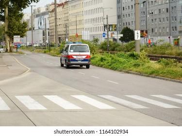 VIENNA, AUSTRIA - AUGUST 24, 2018: Pedestrian crossing markings on asphalt road near Mexikoplatz, a park in the 2nd district (Leopoldstadt) of Vienna