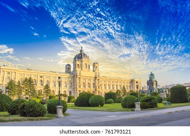 VIENNA, AUSTRIA - August, 24: The Museum of Art History and the bronze monument of the Empress Maria Theresa stand in the rays of the sun on August, 24 2017 in Vienna, Austria