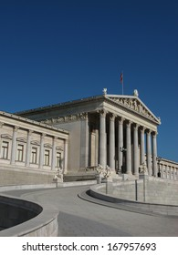 VIENNA, AUSTRIA - AUGUST 25: Austrian Parliament Building shown on 25 August 2009 in Vienna. The neo-Greek style building houses the Parliament of Austria and is also a tourist attraction in Vienna.