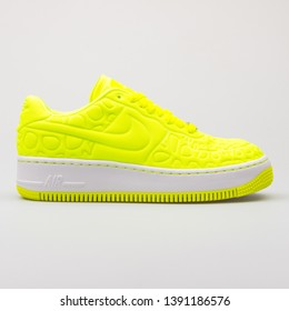 VIENNA, AUSTRIA - AUGUST 28, 2017: Nike Air Force 1 Upstep SE volt yellow sneaker on white background.