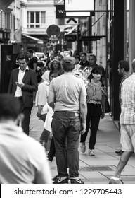 VIENNA, AUSTRIA - AUGUST 28, 2018: standing man in a walking crowd
