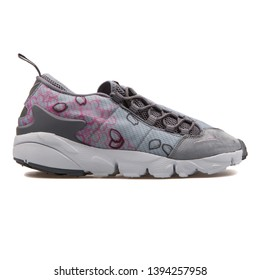 VIENNA, AUSTRIA - AUGUST 30, 2017: Nike Air Footscape NM Premium QS grey and pink sneaker on white background.
