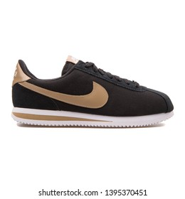 VIENNA, AUSTRIA - AUGUST 30, 2017: Nike Cortez Basic Premium QS black and beige sneaker on white background.