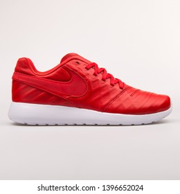 VIENNA, AUSTRIA - AUGUST 30, 2017: Nike Roshe Tiempo VI QS red sneaker on white background.