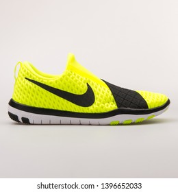 VIENNA, AUSTRIA - AUGUST 30, 2017: Nike Free Connect volt yellow and black sneaker on white background.