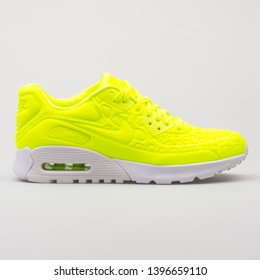 VIENNA, AUSTRIA - AUGUST 30, 2017: Nike Air Max 90 Ultra Plush volt yellow sneaker on white background.