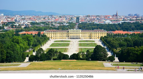 Vienna / Austria — August 6, 2013: panoramic view of Schonbrunn (Schoenbrunn) park and palace, a former imperial summer residence very popular with tourists nowadays located in Vienna, Austria