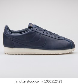 VIENNA, AUSTRIA - AUGUST 7, 2017: Nike Classic Cortez Premium QS TZ blue sneaker on white background.
