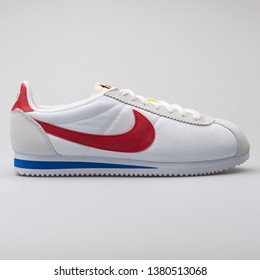 VIENNA, AUSTRIA - AUGUST 7, 2017: Nike Classic Cortez Nylon Premium QS white, red and blue sneaker on white background.