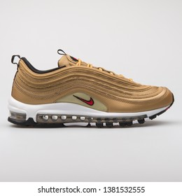 VIENNA, AUSTRIA - AUGUST 7, 2017: Nike Air Max 97 OG QS gold sneaker on white background.