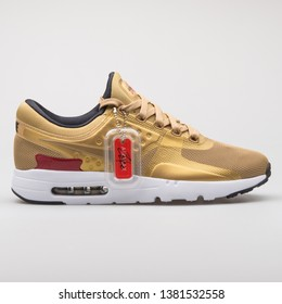 VIENNA, AUSTRIA - AUGUST 7, 2017: Nike Air Max Zero QS gold sneaker on white background.