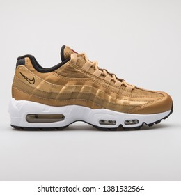 VIENNA, AUSTRIA - AUGUST 7, 2017: Nike Air Max 95 QS gold sneaker on white background.