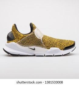 VIENNA, AUSTRIA - AUGUST 7, 2017: Nike Sock Dart QS yellow and black sneaker on white background.