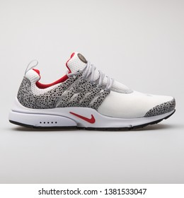 VIENNA, AUSTRIA - AUGUST 7, 2017: Nike Air Presto QS white, black and red sneaker on white background.