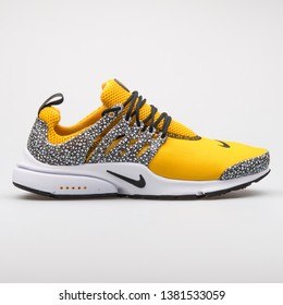 VIENNA, AUSTRIA - AUGUST 7, 2017: Nike Air Presto QS yellow and black sneaker on white background.