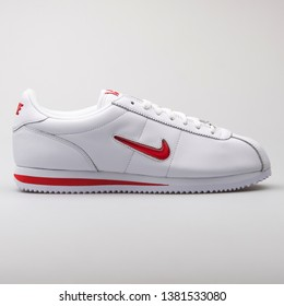 VIENNA, AUSTRIA - AUGUST 7, 2017: Nike Cortez Basic Jewell QS TZ white and red sneaker on white background.